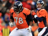 Ryan Clady #78 of the Denver Broncos pass blocks for Peyton Manning against the Baltimore Ravens during the AFC Divisional Playoff Game at Sports Authority Field at Mile High on January 12, 2013