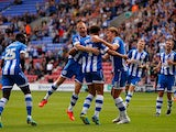 Wigan's Ryan Shotton is congratulated by teammates after scoring the opening goal against Ipswich during their Championship match on September 22, 2013