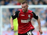 Ryan Tunnicliffe of Ipswich in action during the Sky Bet Championship match between Queens Park Rangers and Ipswich Town at Loftus Road on August 17, 2013