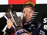 Sebastian Vettel lifts the trophy on the podium after winning the Singapore Formula One Grand Prix on September 22, 2013