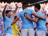 Manchester City's Sergio Aguero celebrates with teammates Alvaro Negredo and Samir Nasri after scoring his team's third goal against Manchester United during their Premier League match on September 22, 2013