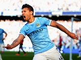 Manchester City's Sergio Aguero celebrates after scoring the opening goal against Manchester United during their Premier League match on September 22, 2013