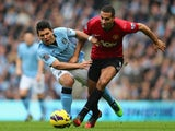 Sergio Aguero and Rio Ferdinand contest possession in the Manchester derby.