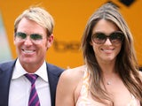 Elizabeth Hurley and Shane Warne attend the Betfair Weekend King George Day and Summer Garden Party at Ascot Racecourse on July 27, 2013