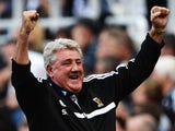 Hull manager Steve Bruce celebrates his team's third goal against Newcastle on September 21, 2013