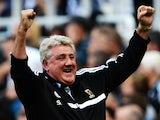 Hull manager Steve Bruce celebrates his team's third goal against Newcastle on September 21, 2013