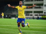 Arsenal's Theo Walcott celebrates after scoring the opening goal against Marseille during the Champions League on September 18, 2013