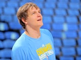 Timofey Mozgov warms up for the Denver Nuggets on April 23, 2013