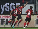 Frankfurt's Vaclav Kadlec is congratulated by team mates after scoring his team's opening goal against Bordeaux during their Europa League group match on September 19, 2013