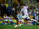 Sevilla's Victor Machin scores the opening goal against Estoril during their Europa League group match on September 19, 2013