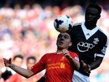 Southampton's Victor Wanyama challenges Liverpool's Spanish striker Iago Aspas on September 21, 2013