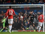 United striker Wayne Rooney opens the scoring against Bayer Leverkusen on September 17, 2013
