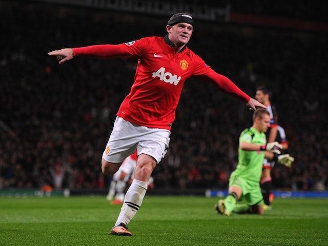 Man United striker Wayne Rooney celebrates scoring his second goal against Bayer Leverkusen on September 17, 2013