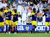 Swansea's Wilfried Bony celebrates with team mates after scoring the opening goal against Valencia during their Europa League group match on September 19, 2013