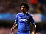 Willian of Chelsea looks on during the UEFA Champions League Group E Match between Chelsea and FC Basel at Stamford Bridge on September 18, 2013