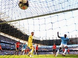 Manchester City's Yaya Toure scores his team second goal against Manchester United during their Premier League match on September 22, 2013
