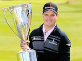 Zach Johnson holds the trophy as he celebrates winning the BMW Championship on September 16, 2013