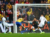 Aaron Ramsey scores Arsenal's second against Swansea on September 28, 2013