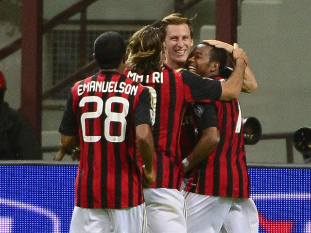 AC Milan's Slovenian midfielder Valter Birsa is congratulated by his teammates after scoring during the Serie A football match AC Milan vs Sampdoria, on Septembre 28, 2013