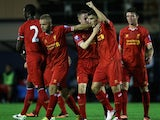 Liverpool's Adam Morgan celebrates scoring from 50 yards out against Manchester City's Under-21s on September 23, 2013