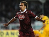 Torino's Alessio Cerci celebrates after scoring his team's second goal against Hellas Verona during their Serie A match on September 25, 2013