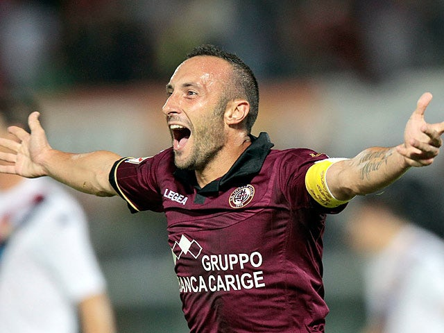 Livorno's Andrea Luci celebrates after scoring the opening goal against Cagliari during their Serie A match on September 25, 2013