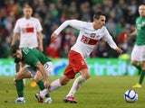 Arkadiusz Milik of Poland beats Wes Hoolahan of Republic of Ireland during the International Friendly match between Republic of Ireland and Poland at Aviva Stadium on February 6, 2013
