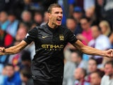 Manchester City player Edin Dzeko celebrates after scoring the second goal during the Barclays Premier League match between Aston Villa and Manchester City at Villa Park on September 28, 2013