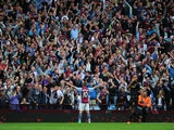 Aston Villa player Andreas Weimann takes the applause of the Holte end after scoring the third Villa goal during the Barclays Premier League match between Aston Villa and Manchester City at Villa Park on September 28, 2013