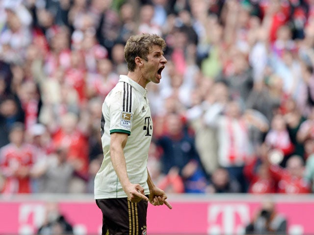 Bayern Munich's striker Thomas Muller celebrates after the first goal for Munich during the German first division Bundesliga football match Bayern Muenchen v VfL Wolfsburg in Munich, Germany, on September 28, 2013