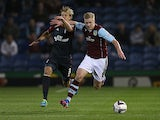 Burnley'a Ben Mee and Forest's Dan Harding battle for the ball during their League Cup match on September 24, 2013
