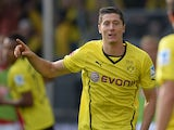 Dortmund's Polish striker Robert Lewandowski celebrates during the German first division Bundesliga football match Borussia Dortmund vs SC Freiburg in Dortmund , Germany, on September 28, 2013