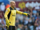 Aston Villa's US goalkeeper Brad Guzan gestures during the English Premier League football match between Aston Villa and Liverpool at Villa Park in Birmingham on August 24, 2013