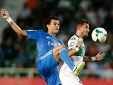 Real's Pepe and Elche's Coro battle for the ball during their La Liga match on September 25, 2013