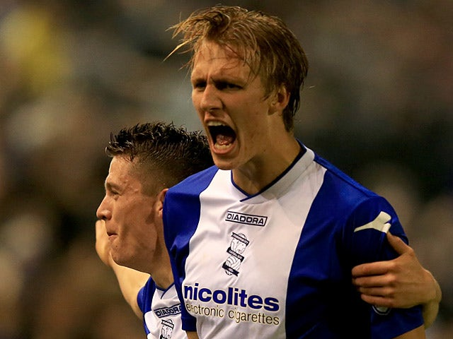 Birmingham's Dan Burn celebrates after scoring the opening goal against Swansea during their League Cup match on September 25, 2013