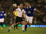 Everton's Darren Gibson and Fulham's Scott Parker battle for the ball during their League Cup match on September 24, 2013
