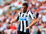 Davide Santon of Newcastle United runs with the ball during the Barclays Premier League match between Newcastle United and Fulham at St James' Park on August 31, 2013