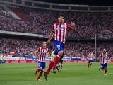 Atletico Madrid's Diego Costa celebrates after scoring his second goal against Osasuna during their La Liga match on September 24, 2013