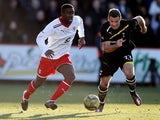 Don Cowan of Stevenage in action with Ryan Nelsen of Tottenham during the FA Cup Fifth Round match between Stevenage and Tottenham Hotspur at The Lamex Stadium on February 19, 2012