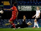 England's Ellen White scores a goal against Turkey on September 26, 2013