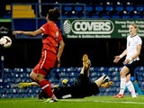 England's Ellen White scores a goal against Turkey on September 26, 2013