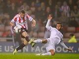 Sunderland's Emanuele Giaccherini and Peterborough's Jack Payne battle for the ball during their League Cup match on September 24, 2013
