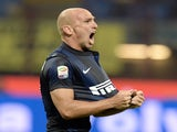 Inter's Esteban Cambiasso celebrates a goal against Fiorentina on September 26, 2013