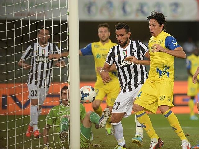 Juventus' Fabio Quagliarella scores his team's equaliser against Chievo Verona during their Serie A match on September 25, 2013