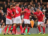 Steven Caulker of Cardiff City celebrates scoring the opening goal with team mates during the Barclays Premier League match between Fulham and Cardiff City at Craven Cottage on September 28, 2013