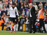 Bryan Ruiz of Fulham celebrates his goal with manager Martin Jol during the Barclays Premier League match between Fulham and Cardiff City at Craven Cottage on September 28, 2013