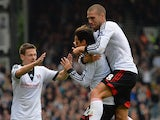 Bryan Ruiz of Fulham is congratulated by Sascha Riether and Pajtim Kasami after scoring their first goal during the Barclays Premier League match between Fulham and Cardiff City at Craven Cottage on September 28, 2013