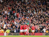 Cardiff City fans celebrate Jordon Mutch's winning goal during the Barclays Premier League match between Fulham and Cardiff City at Craven Cottage on September 28, 2013