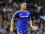 Chelsea's English defender Gary Cahill runs with the ball during the English Premier League football match between Chelsea and Fulham at Stamford Bridge in London on September 21, 2013