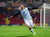 Norwich City's Gary Hooper celebrates after scoring the winner against Watford during their League Cup match on September 24, 2013
